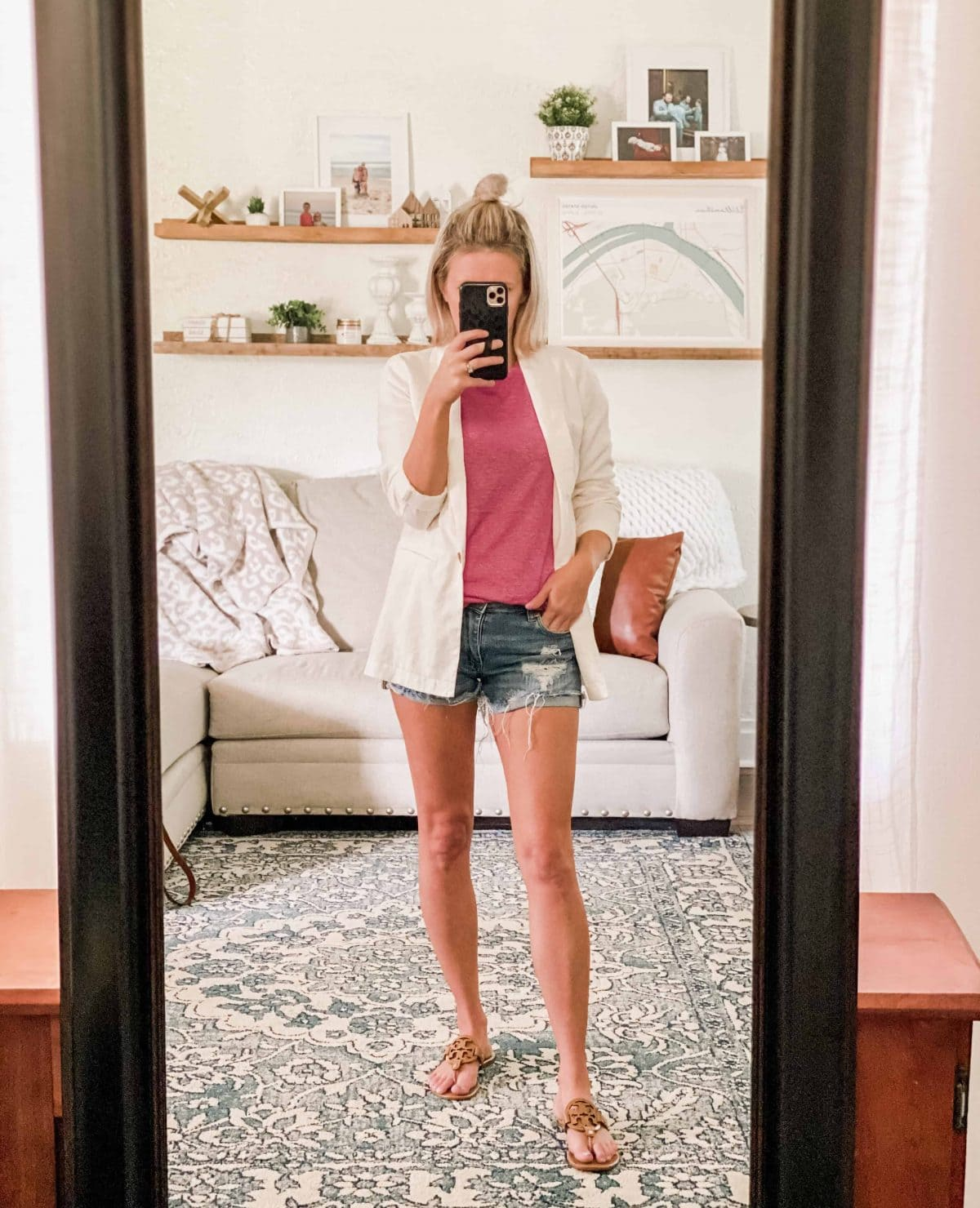 Woman with white blazer, pink tank, and shorts. mirror selfie
