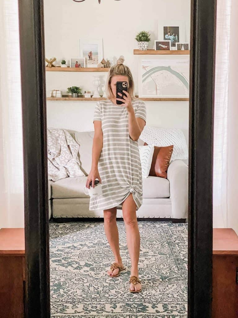 Amazon Prime Wardrobe Summer edit. mirror selfie, woman standing in mirror grey and white striped dress tied at the bottom with coffee cup in hand