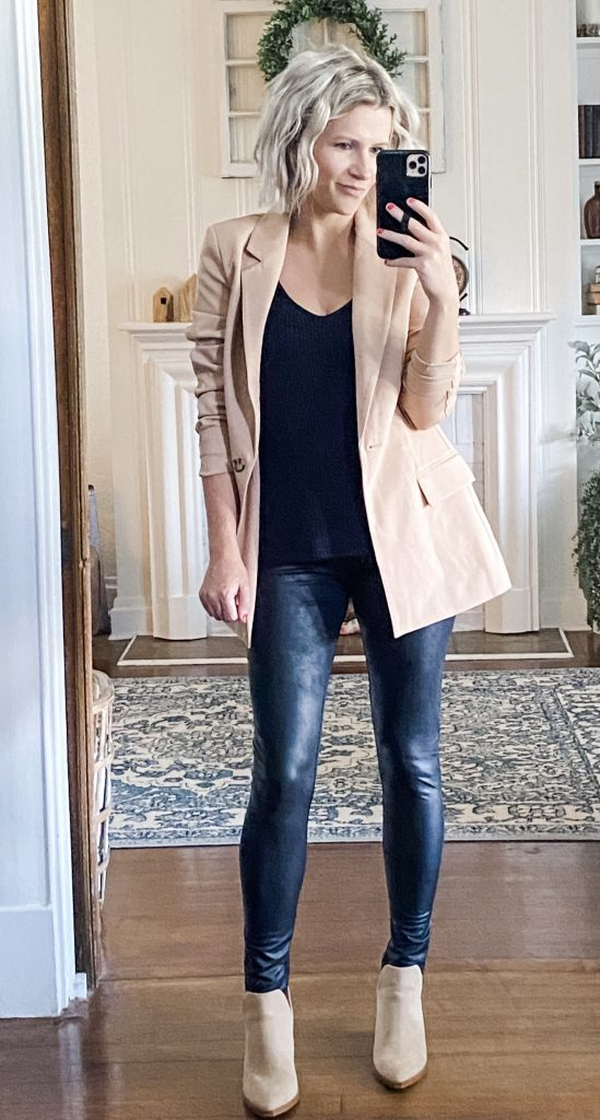 Woman wearing tan blazer, faux leather leggings, and black knit tank from Amazon.