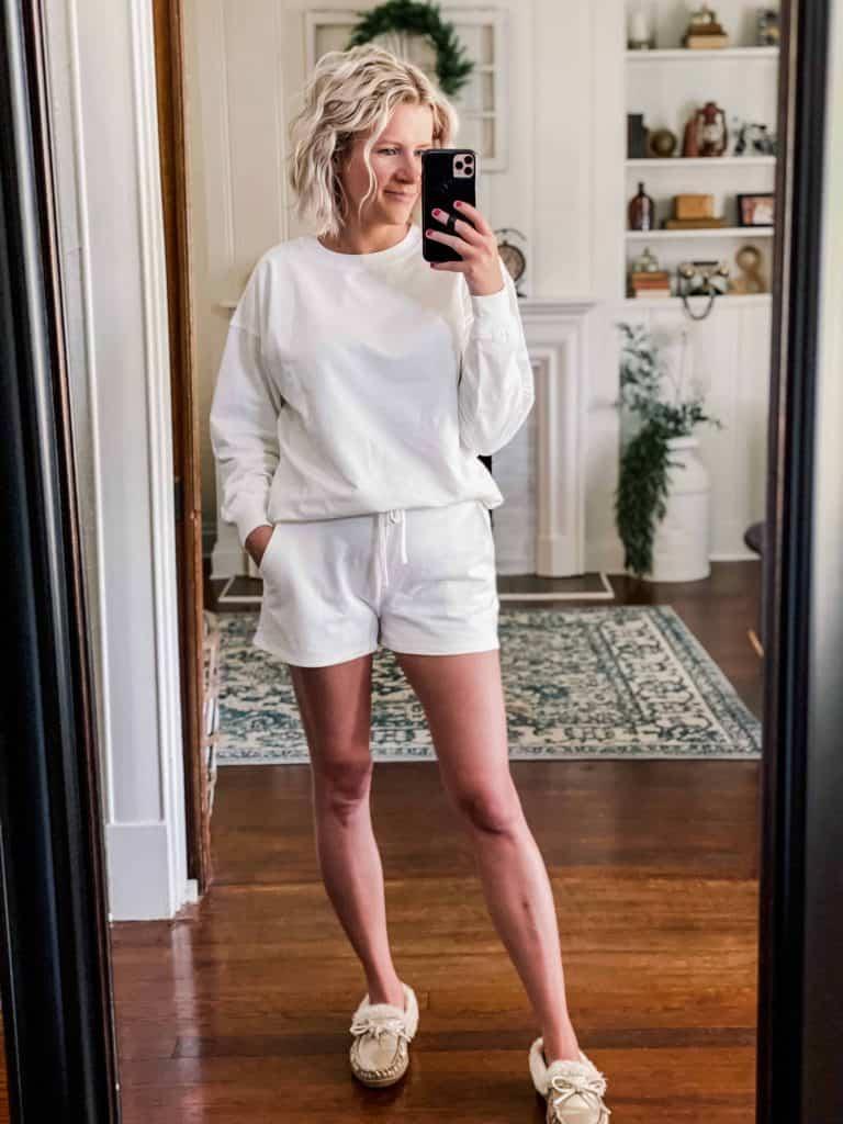 Woman wearing an amazon white sweatshirt and white shorts loungewear